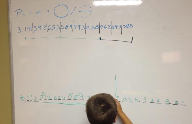 kid memorizes 14 digits of pi